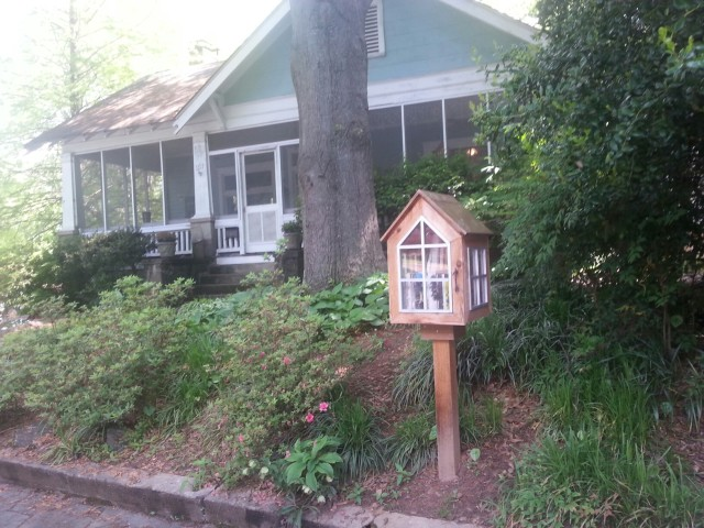Note the little library. My Favorite World.